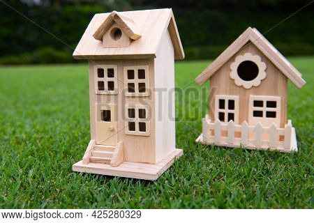 Neighbors House Concept. Insurance Or House Purchase. Houses In The Village. Two Wooden Houses With
