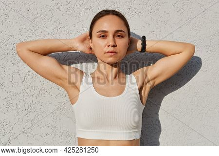 Young Adult Attractive Slim Female Wearing White Top Standing Isolated Over Gray Background Outdoor,