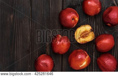 Plums On A Dark Rustic Table, Ripe Fruit Layout. Top View Of Ripe Plums With Copy Space. Idea For In