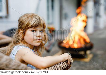 Little Toddler Girl Girl Roasting Marshmallows On Stick At Bonfire. Child Having Fun At Camp Fire. C