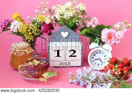Calendar For July 12 : The Name Of The Month Of July In English, Cubes With The Number 12, A Cup Of