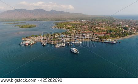 Aerial View Ferry Port Gilimanuk With Ferry Boats, Vehicles. Ferries Transport Vehicles And Passenge