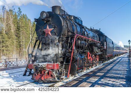 Ruskeala, Russia - March 10 10, 2016: Soviet Steam Locomotive L-2198 With Tourist Train