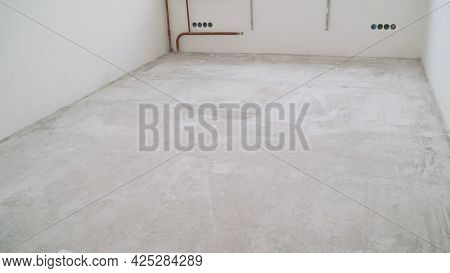 Concrete Floor In A New Apartment. Concrete Floor Before Processing. Unfinished Building Interior, D