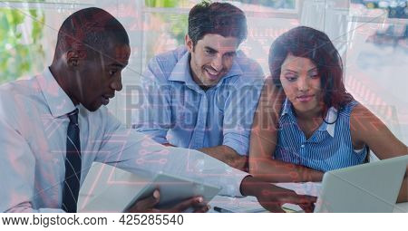 Composition of computer circuit board over business people using laptop. global business, digital interface, technology and networking concept digitally generated image.