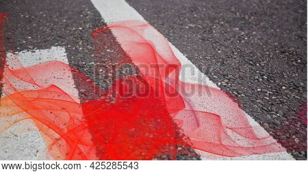 Red smoke effect against close up view of pedestrian crossing on the road. acceleration speed motion and technology concept