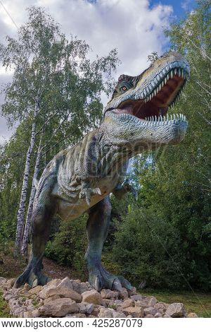 Kotelnich, Russia - August 30, 2017: Life-size Carnivorous Tyrannosaurus Rex In The Dinosaur Park