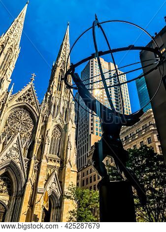 A Rear, Diagonal Shot Of The Atlas Statue Facing St. Patrick\'s Cathedral Church In New York City. O