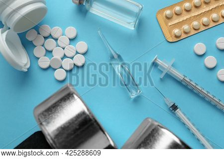 Different Drugs And Sports Equipment On Turquoise Background, Flat Lay. Doping Control