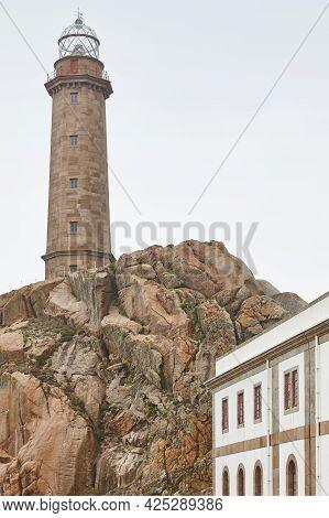 Lighthouse In Atlantic Northern Spanish Coastline Cliffs. Vilan, Camarinas, Galicia