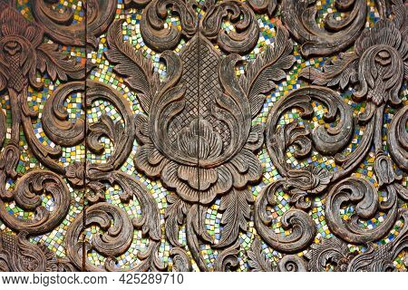 Lanna Artwork, Wood Carving, High Relief Decorated With Colorful Glass. Northern Thai Arts