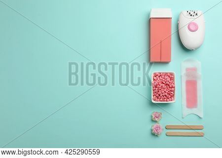 Set Of Epilation Products On Turquoise Background, Flat Lay. Space For Text