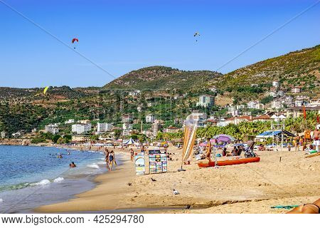 Alanya, Turkey - October 23, 2020: People Are Relaxing, Swimming And Sunbathing On Cleopatra Beach I