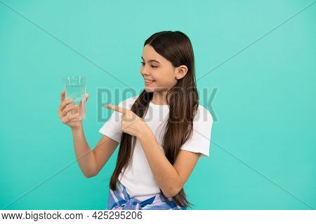 Happy Kid Pointing Finger On Glass Of Water To Keep Daily Water Balance In Body, Hydration.