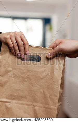 Close Up Hands Of Businesswoman In Company Office Taking Delivery Of Fresh Food From Courier. Employ
