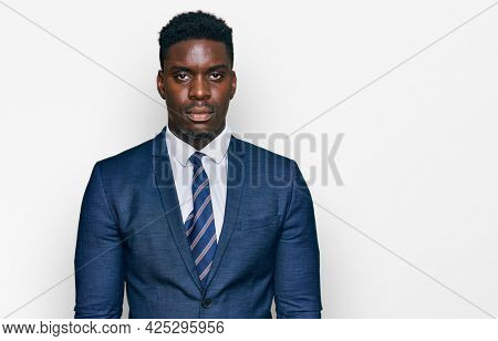 Handsome business black man wearing business suit and tie depressed and worry for distress, crying angry and afraid. sad expression.