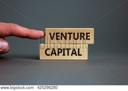 Venture Capital Symbol. Wooden Blocks With Words Venture Capital On Beautiful Grey Background, Copy