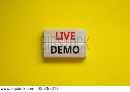 Live Demo Symbol. Concept Words 'live Demo' On Wooden Blocks On A Beautiful Yellow Background. Copy
