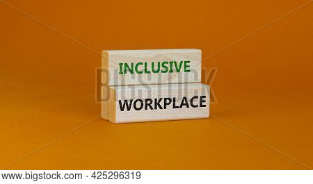 Inclusive Workplace Symbol. Wooden Blocks With Words Inclusive Workplace On Beautiful Orange Backgro