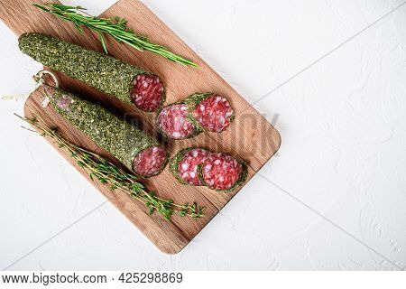 Sliced Cuts Of Fuet Salami Sausage On White Textured Background With Space For Text.