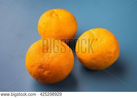 Organic Clementine Or Tangerine Set, On Blue Textured Summer Background