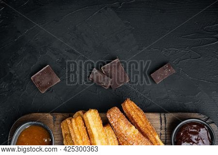 Churros With Chocolate, Traditional Spanish Cusine, On Black Background, Top View Flat Lay With Spac