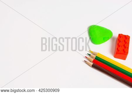 School Supplies And Office Supplies Are On A White Background. White Background With Colored Pencils