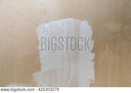 A Thin Layer Of White Putty On Beige Gypsum Plaster