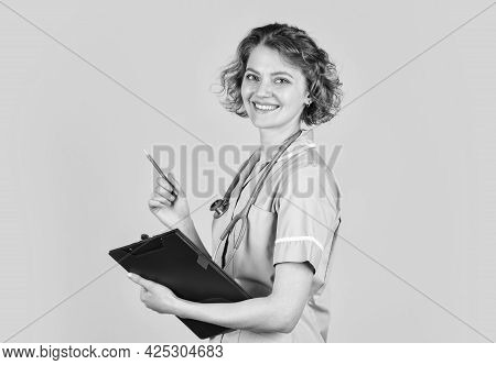 Nurse Informing. Medical Worker. Medical Insurance. Writing Protocol. Sign Here. Woman Doctor Prescr