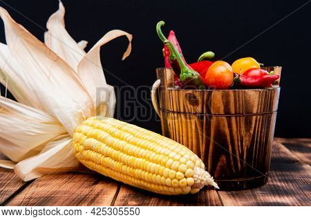 Mexican Flavor. Mexican Vegetables. Chili Peppers And Cherry Tomatoes In Wooden Bucket. Corncob