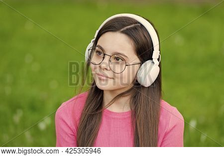 Feel The Sound. Little Child Listen To Sound Track Summer Outdoor. Small Girl Enjoy Music Playing In