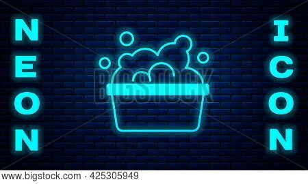 Glowing Neon Plastic Basin With Soap Suds Icon Isolated On Brick Wall Background. Bowl With Water. W