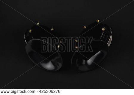 Two Electric Horn For Car, Snail Shaped Horn, Isolate On Black Background, Close-up, Selective Focus