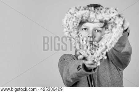 Celebration Of Love. Little Child Hold Wicker Heart. Valentines Day Celebration. Holiday Celebration