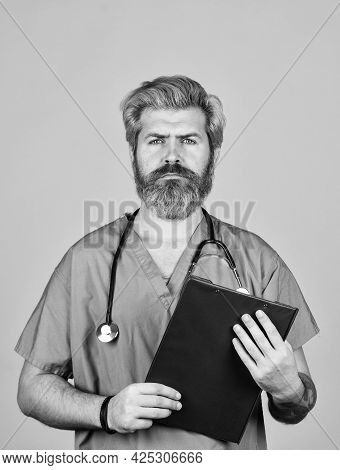 Health Is Wealth. Physician Doctor With Stethoscope And Clipboard. Therapist Writing Prescription. M