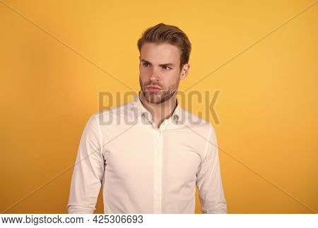Handsome Guy With Bristle Wearing White Shirt Standing On Orange Background, Business Fashion