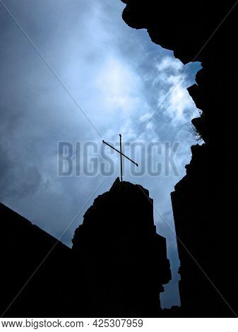 Silhouette Of The Cross And The Walls Of The Medieval Armenian Church Amenaprkich In The Monastic Co