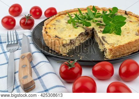 Closeup Wide Studio Shot Of Freshly Baked Yellow French Salty Cake, Or Quiche With Mushrooms, Red Ch