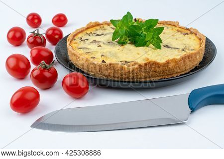 Closeup Wide Studio Shot Of Freshly Baked Yellow French Salty Cake, Or Quiche, With Mushrooms, Red C