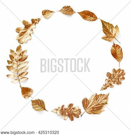 Gold Autumn Leaves On White Background. Autumn Concept. Autumn Leaves Circle Shape Frame And Creativ