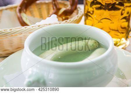 Bavarian cuisine - White munich sausages in pot