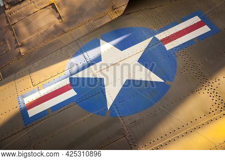 US Air Force stars and stripes close-up on the side of old military aircraft