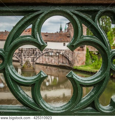 View of Nuremberg in Germany through bridge railing. Architectural detail, cityscape
