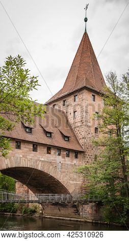Medieval tower with bridge over river in the Old town of Nuremberg, Germany