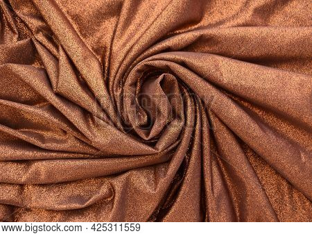 Bright Background Of Brown Fabric With Sequins.