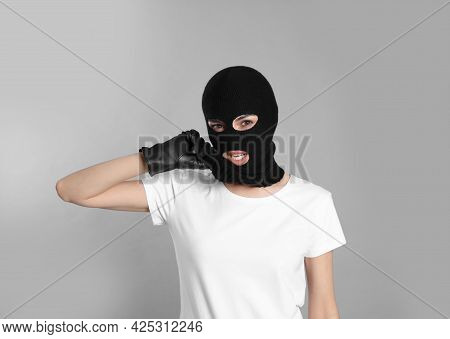 Woman Wearing Knitted Balaclava On Grey Background