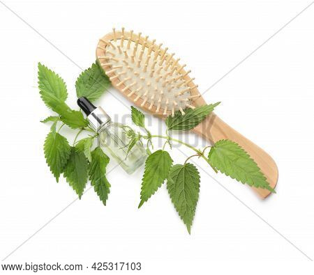 Stinging Nettle Extract In Bottle, Green Leaves And Brush On White Background, Top View. Natural Hai