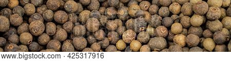 Banner With Large Pile Of Allspice Peas. Food Background.