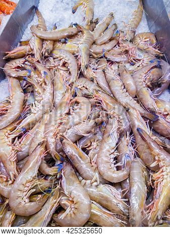 Fresh Uncooked Shrimps Piled Up On Ice Bed For Sale At A Local Seafood Store.