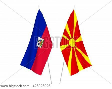 National Fabric Flags Of North Macedonia And Republic Of Haiti Isolated On White Background. 3d Rend